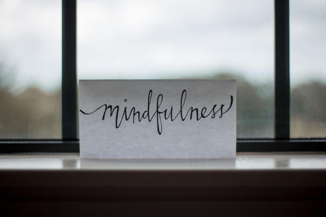 written word of mindfulness in a piece of paper
